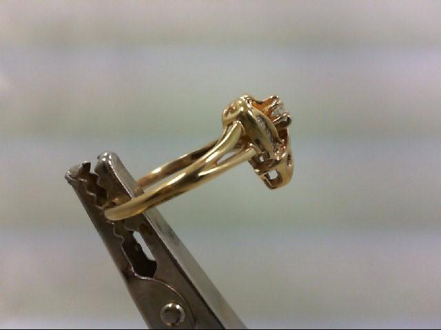 Lady's Diamond Cluster Ring 10 Diamonds .28 Carat T.W. 10K Yellow Gold 2.4g