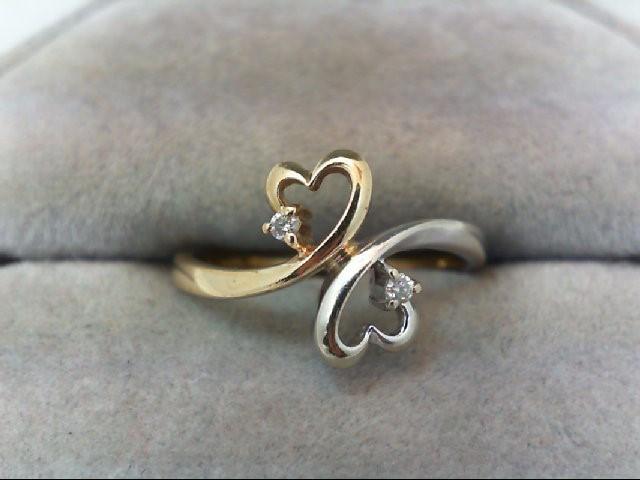 Lady's Diamond Fashion Ring 2 Diamonds .04 Carat T.W. 10K 2 Tone Gold 1.9g
