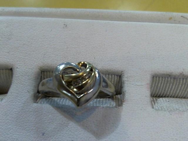 Lady's Diamond Fashion Ring 3 Diamonds .06 Carat T.W. 10K 2 Tone Gold 2.4g