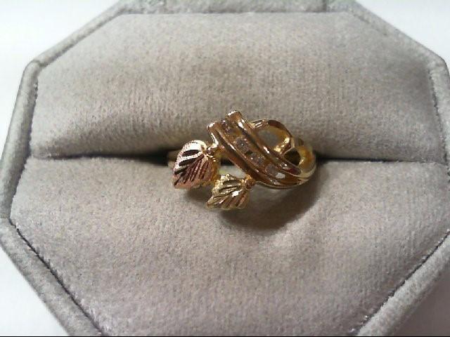 Lady's Diamond Fashion Ring 4 Diamonds .13 Carat T.W. 10K Tri-color Gold 2.9g