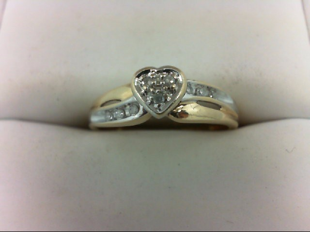 Lady's Diamond Cluster Ring 9 Diamonds 0.09 Carat T.W. 10K Yellow Gold 2.3g