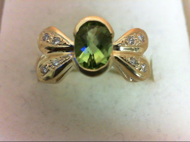 Peridot Lady's Stone & Diamond Ring 8 Diamonds .16 Carat T.W. 18K Yellow Gold