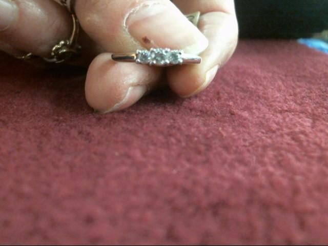 Lady's Diamond Fashion Ring 3 Diamonds .22 Carat T.W. 14K White Gold 1.7dwt