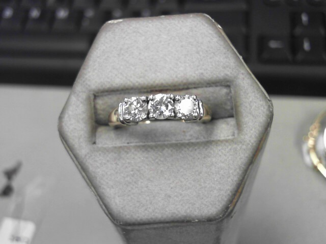 Lady's Diamond Fashion Ring 3 Diamonds .99 Carat T.W. 14K Yellow Gold 4.8g