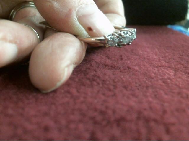 Lady's Diamond Fashion Ring 3 Diamonds .27 Carat T.W. 10K White Gold 1.6dwt