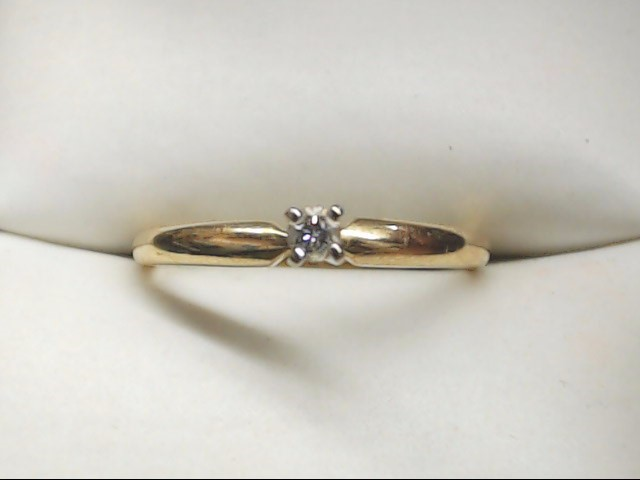 Lady's Diamond Solitaire Ring .04 CT. 14K Yellow Gold 1.5g Size:6.5