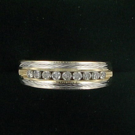 Lady's Diamond Wedding Band 9 Diamonds .18 Carat T.W. 14K Yellow Gold 4.2dwt