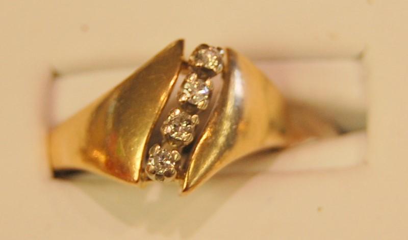 Lady's Diamond Fashion Ring 4 Diamonds .04 Carat T.W. 14K Yellow Gold 3.1g