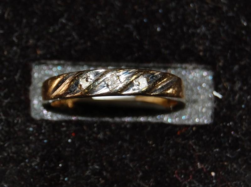 Lady's Diamond Wedding Band 3 Diamonds .03 Carat T.W. 10K Yellow Gold 1.5g