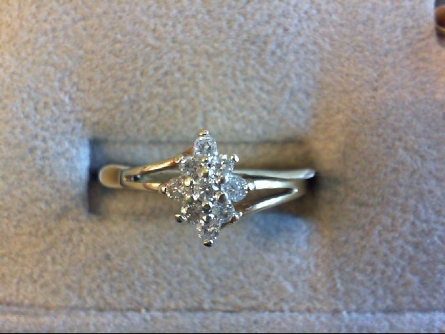 Lady's Diamond Cluster Ring 9 Diamonds .28 Carat T.W. 10K Yellow Gold 1.8g