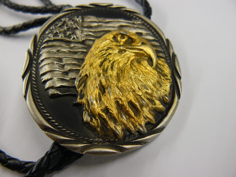 PEWTER EAGLE WITH GOLD TONE BOLO TIE
