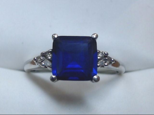 Blue Stone Lady's Stone & Diamond Ring 6 Diamonds .06 Carat T.W. 10K White Gold
