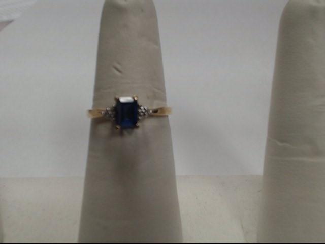 Blue Stone Lady's Stone & Diamond Ring 3 Diamonds .03 Carat T.W.