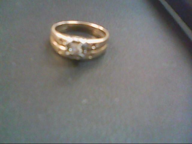 Lady's Diamond Wedding Set .12 CT. 14K Yellow Gold 3.7g Size:6