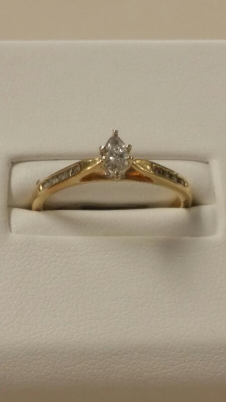 Lady's Diamond Engagement Ring 9 Diamonds .74 Carat T.W. 10K Yellow Gold 1.5dwt