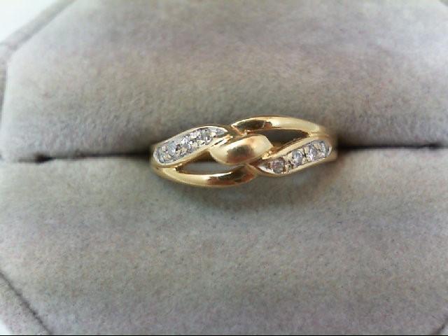 Lady's Diamond Wedding Band 8 Diamonds .08 Carat T.W. 18K Yellow Gold 2.4g