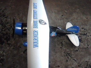 ERTL DIECAST Toy WARNER BROTHERS TOY STUNT AIRPLANE
