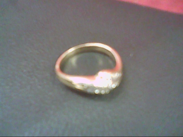 Lady's Diamond Cluster Ring 12 Diamonds .12 Carat T.W. 14K Yellow Gold 3g