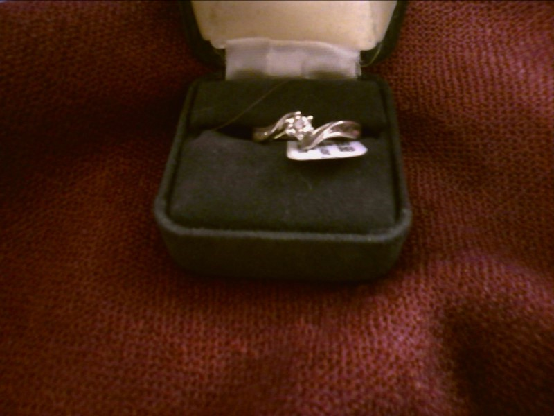 Lady's Silver-Diamond Ring 7 Diamonds .09 Carat T.W. 925 Silver 1.4dwt