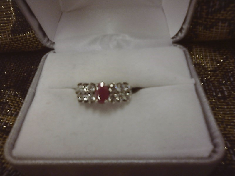 STERLING SILVER RING - RED OVAL STONE W/ SIX CLEAR STONES ON EITHER SIDE SIZE: 8