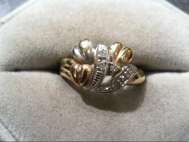 Lady's Diamond Fashion Ring 6 Diamonds .12 Carat T.W. 10K Tri-color Gold 3.7g