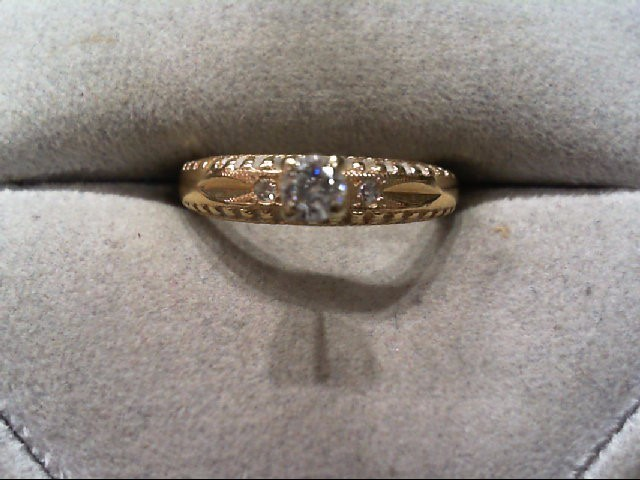 Lady's Diamond Engagement Ring 3 Diamonds .17 Carat T.W. 14K Yellow Gold 2.3g