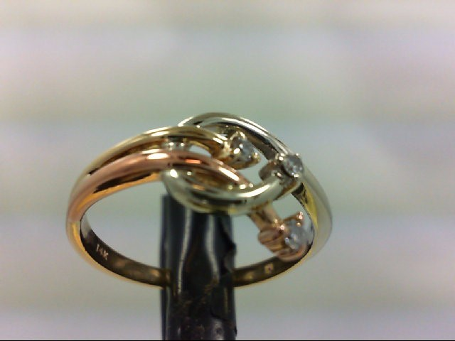 Lady's Diamond Fashion Ring 3 Diamonds .05 Carat T.W. 14K Tri-color Gold 2.7g