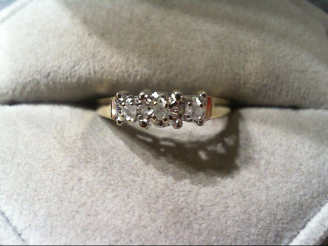 Lady's Gold-Diamond wedding band 3 Diamonds .06 Carat T.W. 10K Yellow Gold