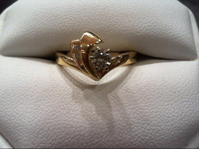 Lady's Diamond Fashion Ring 3 Diamonds .28 Carat T.W. 14K Yellow Gold 4.2g