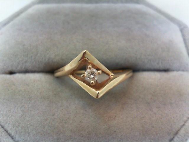 Lady's Diamond Fashion Ring .07 CT. 14K Yellow Gold 2.7g