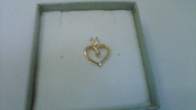 Gold-Diamond Solitaire Pendant .01 CT. 14K Yellow Gold 0.8g