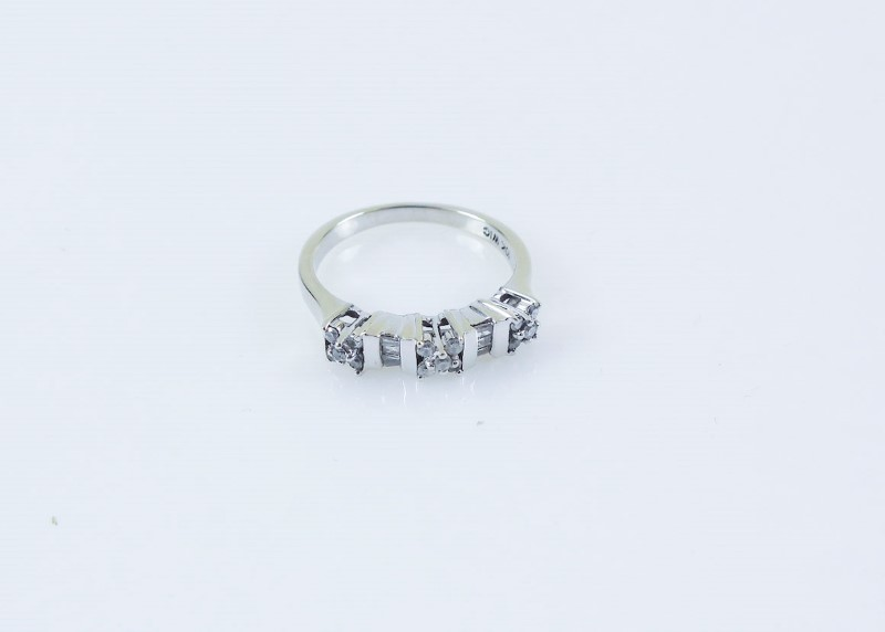 Lady's Diamond  Ring 21 Diamonds .21 Carat T.W. 10K WG size 8