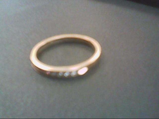 Lady's Diamond Wedding Band 10 Diamonds .10 Carat T.W. 10K Yellow Gold 1.6g