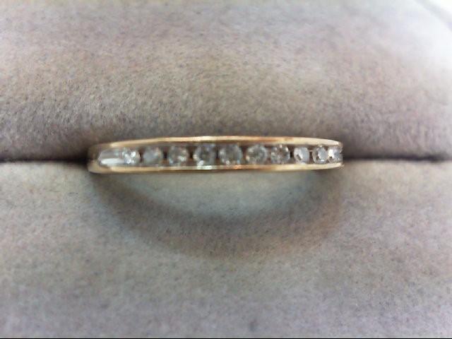 Lady's Diamond Wedding Band 10 Diamonds .10 Carat T.W. 10K Yellow Gold 1.5g