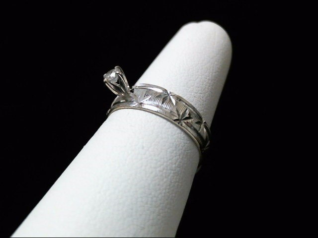 Lady's Diamond Solitaire Ring .12 CT. 14K White Gold 2.4g Size:6