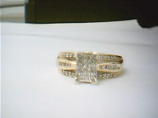 Lady's Diamond Fashion Ring 66 Diamonds .66 Carat T.W. 10K Yellow Gold 3.7g