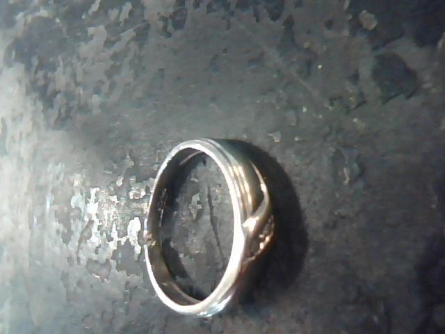 Lady's Gold Ring 10K White Gold 1.2dwt