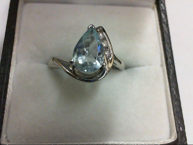 Synthetic Blue Stone Lady's Stone & Diamond Ring 3 Diamonds 0.06 Carat T.W. 10K