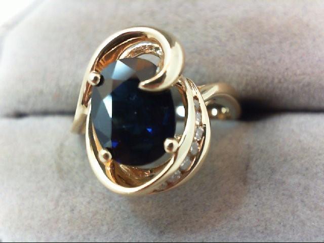 Sapphire Lady's Stone & Diamond Ring 7 Diamonds .07 Carat T.W. 14K Yellow Gold