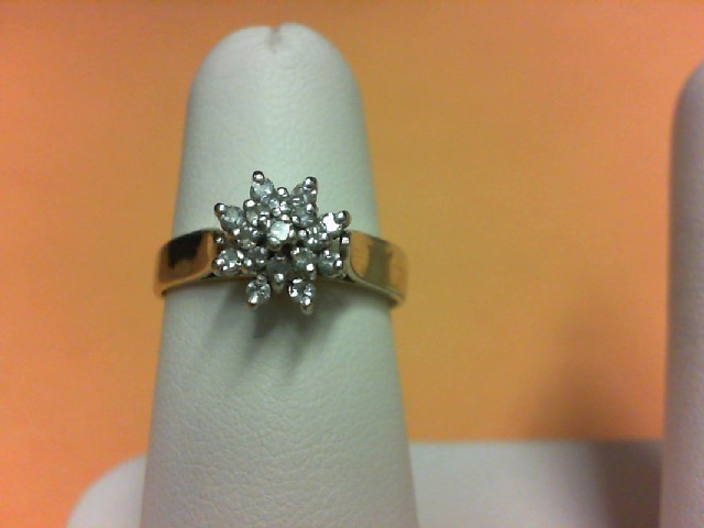 Lady's Diamond Cluster Ring 16 Diamonds .64 Carat T.W. 10K Yellow Gold 3g