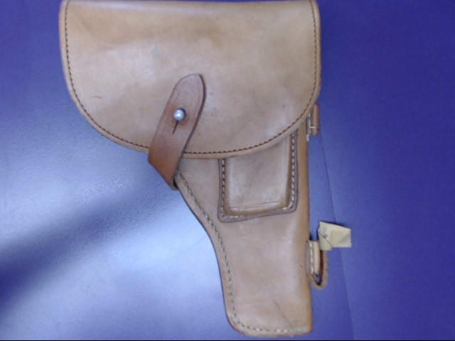 TAN LEATHER GUN HULSTER IN VERY GOOD CONDITION. BLUE CORDUROY INSIDE.
