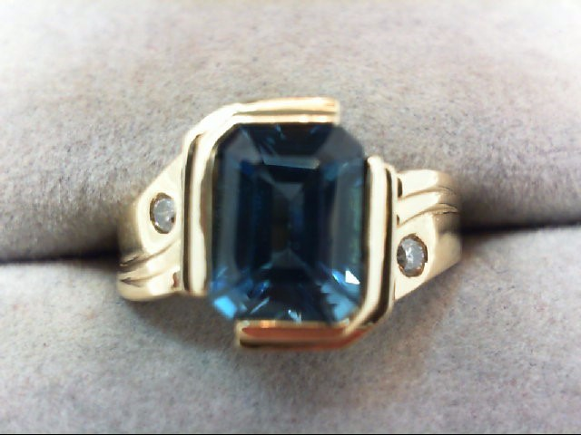 Blue Topaz Lady's Stone & Diamond Ring 2 Diamonds .04 Carat T.W.