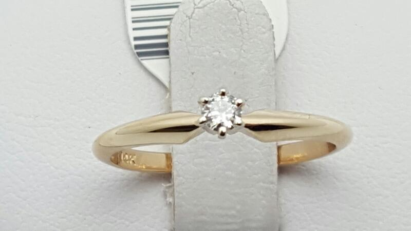 Lady's Diamond Solitaire Ring .09 CT. 14K Yellow Gold 1.8g Size:6