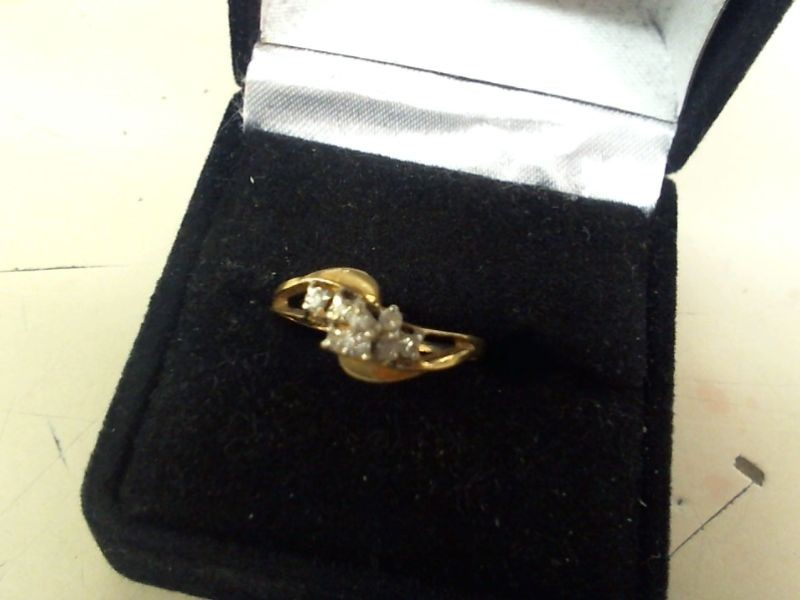 Lady's Diamond Cluster Ring 8 Diamonds .16 Carat T.W. 14K Yellow Gold 1.4g