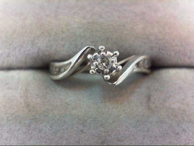 Lady's Silver-Diamond Ring 7 Diamonds .11 Carat T.W. 925 Silver 2.1g