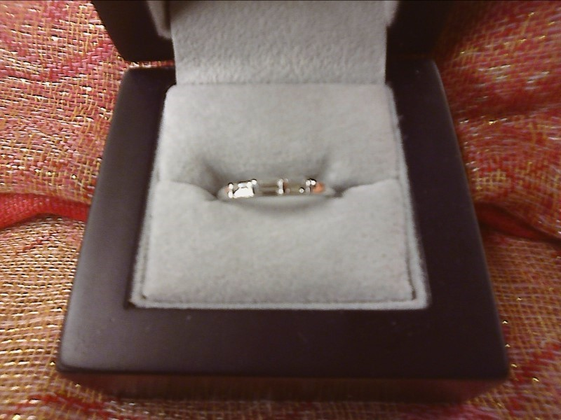 14K WHITE GOLD RING-3 EMERALD CUT DIAMONDS IN BAND SIZE: 6