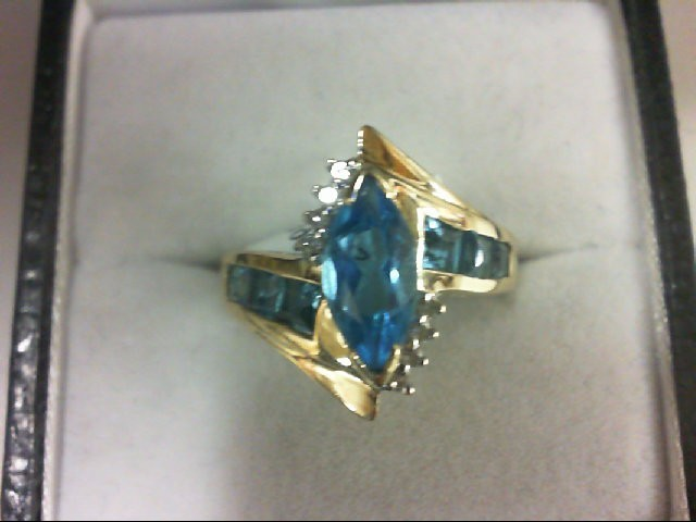 Blue Topaz Lady's Stone & Diamond Ring 8 Diamonds 0.08 Carat T.W. 14K Yellow Gol