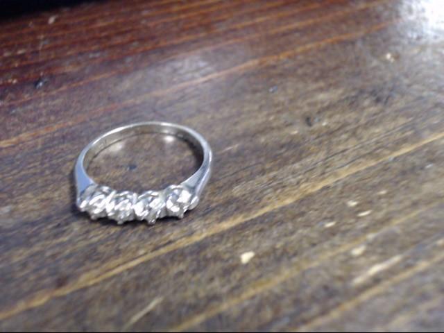Lady's Diamond Cluster Ring 4 Diamonds .08 Carat T.W. 14K White Gold 2g