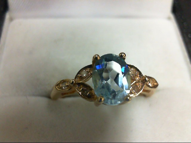Blue Topaz Lady's Stone & Diamond Ring 6 Diamonds 0.06 Carat T.W. 14K Yellow Gol