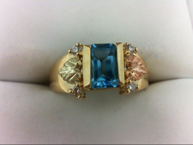 Blue Topaz Lady's Stone & Diamond Ring 4 Diamonds 0.08 Carat T.W. 10K Yellow Gol